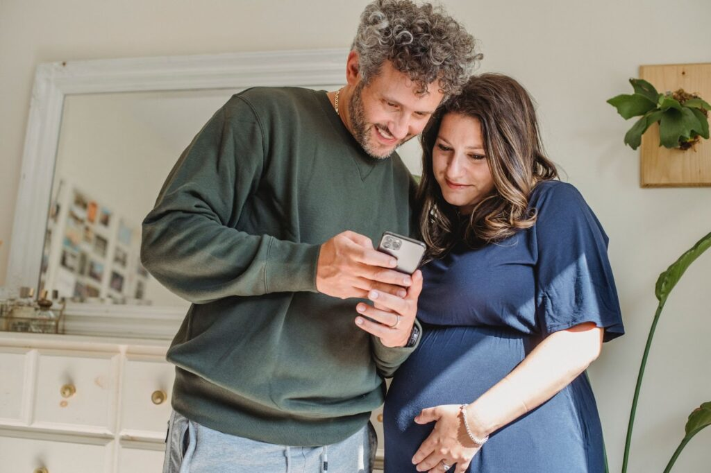 image of parents looking at phone